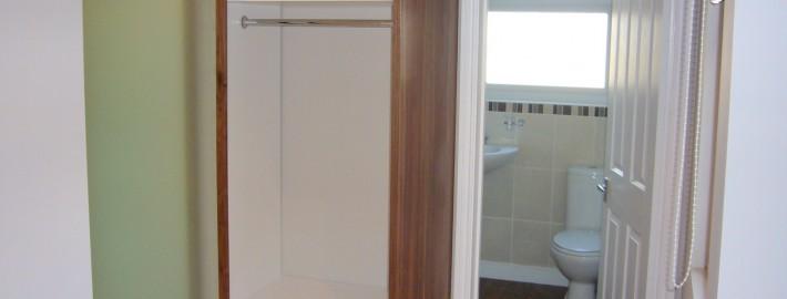 walnut wardrobe with glass sliding doors